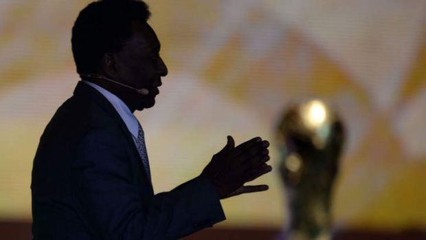 Footballing legend: Brazil's Pele with the coveted World Cup trophy.