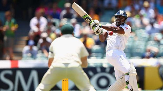 Michael Carberry hits the ball to David Warner.