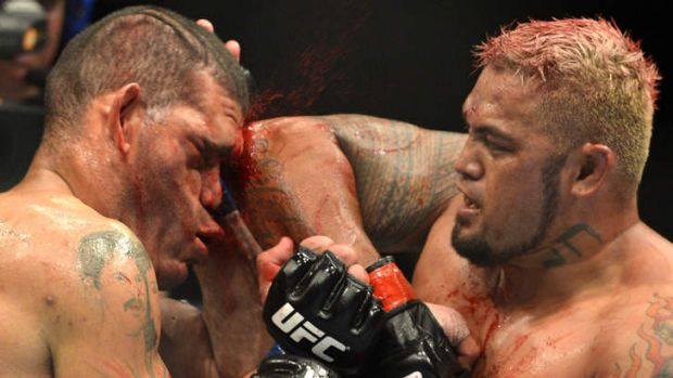 Mark Hunt connects with an elbow during the UFC Brisbane bout between Mark Hunt and Antonio 'Big Foot' Silva of Brazil ...