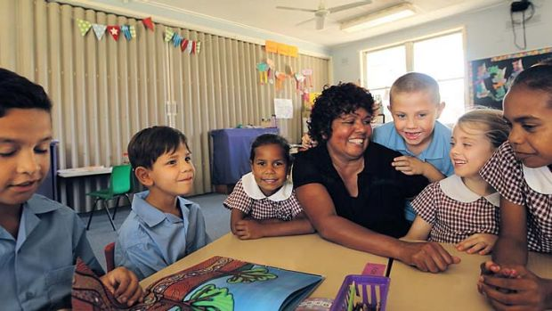 Listen up: Moree East Public School principal Muriel Kelly  with some of her charges.