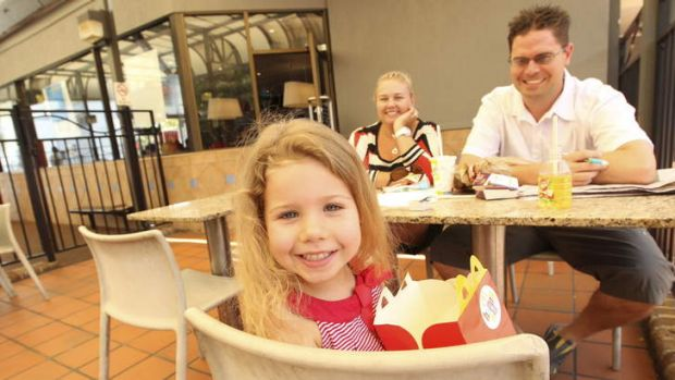 Not sure about quality: Yervette and Stephen Spratt with daughter Jessica at North Parramatta McDonald's.