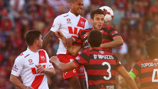 Patrick Kisnorbo of the Heart and Matthew Spiranovic of the Wanderers jump for the ball.