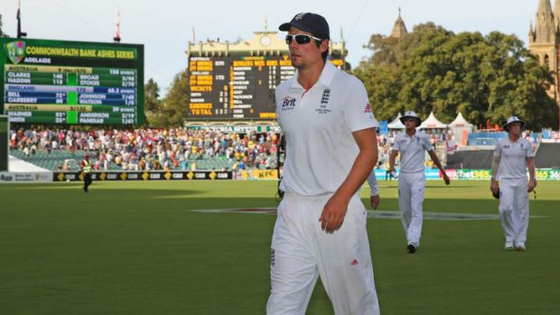 Rallying call: England captain Alastair Cook cut a lonely figure as he left the pitch in Adelaide.