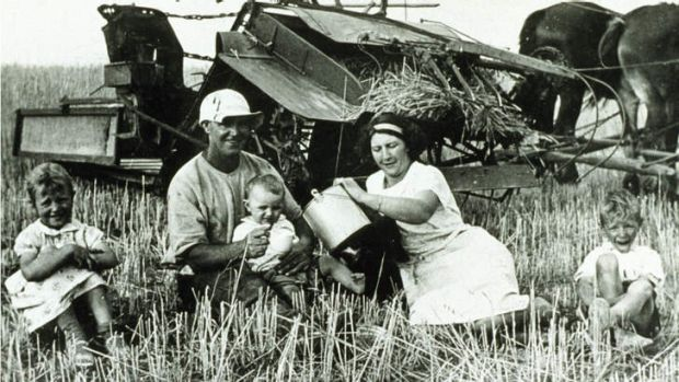 A photo hanging in Barnaby Joyce's office of Frank and Jessie Marsh and children having a tea break during harvesting in ...