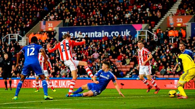 Peter Crouch of Stoke scores against Chelsea.