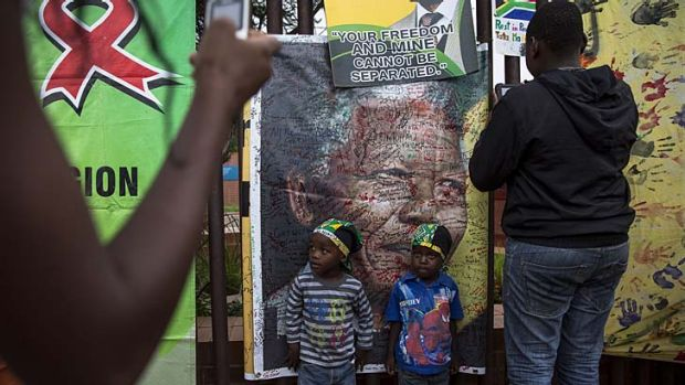 Citizens show their respect for Mandela in Soweto, South Africa.