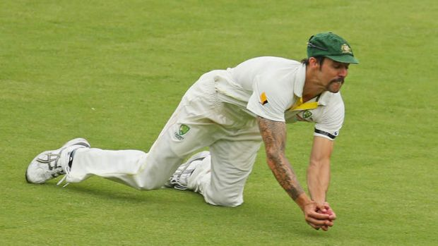 Mitch Johnson sprawls forward to claim a difficult catch off England's Ian Bell just before tea.