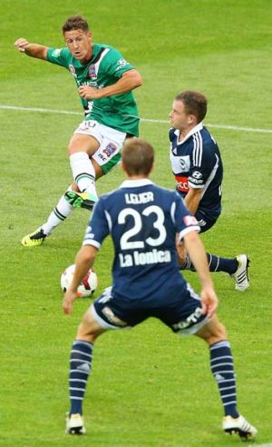 Nathan Burns of the Jets scores one of his goals against Melbourne Victory.