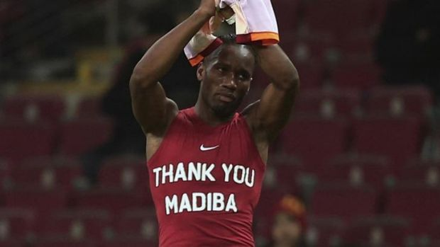 Didier Drogba shows off his tribute to Mandela.