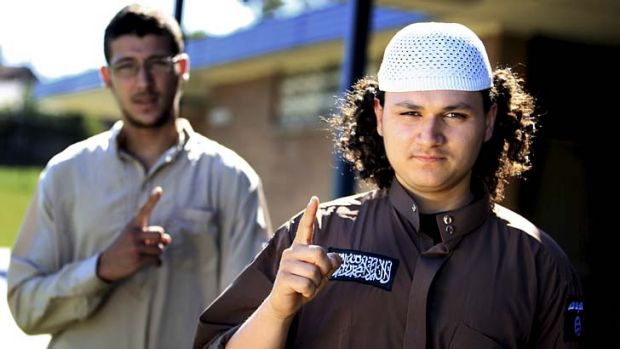 Posted lectures on Syria: Abu Bakr, right, who has been asked by ASIO to hand in his passport.