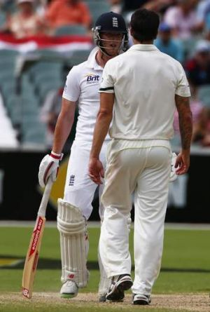 Coming together: Australia's Mitchell Johnson has words with England's Ben Stokes after the collision.