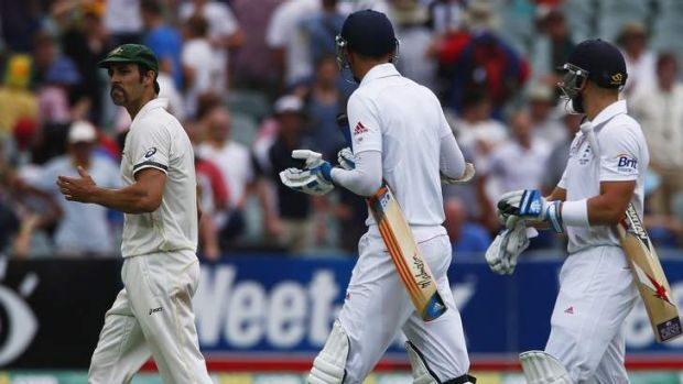 Not mincing words: Australia's Mitchell Johnson argues with England's Stuart Broad (centre).