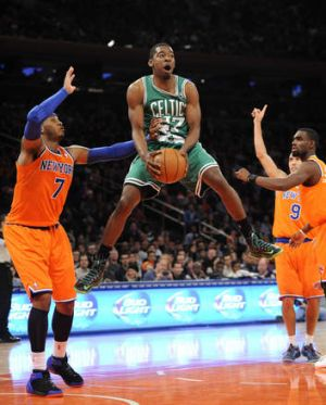 Boston's Jordan Crawford leaps next to New York Knicks forward Carmelo Anthony after getting fouled during the second ...