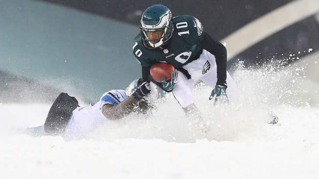 Camouflaged Lion: Jeremy Ross of the Detroit Lions can barely be seen as he tackles DeSean Jackson of the Philadelphia ...