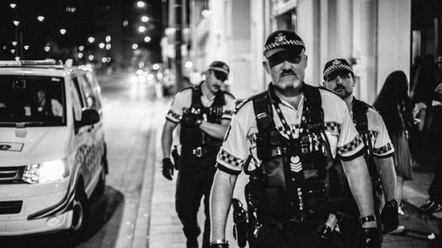Police on the beat at night near Civic nightclubs.