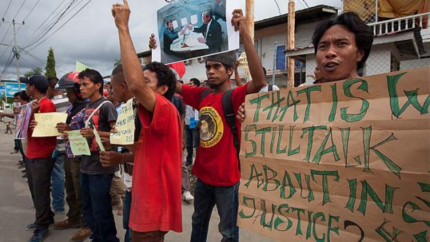 Spying scandal: Protesters hold up signs during an anti-Australia rally in Dili, East Timor. The protests were in ...