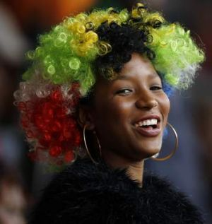 Celebrating Madiba's life ... A woman smiles during the national memorial service for Nelson Mandela.