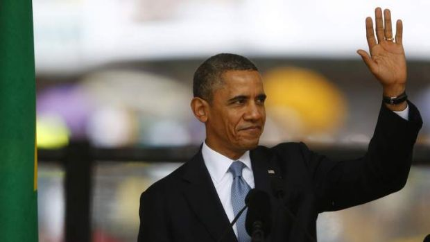 US President Barack Obama greets the crowd before giving his powerful speech at the memorial service for late South ...