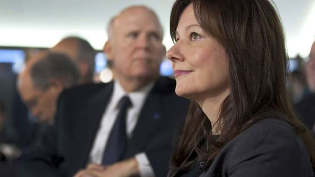 Changing of the guard: Mary Barra with outgoing Chairman and CEO Daniel Akerson.