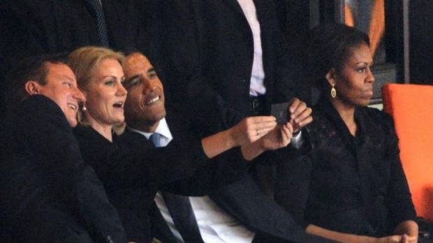 "Barack Obama and David Cameron take a ""selfie"" with Danish PM Helle Thorning-Schmidt, but Michelle Obama seems less than ..."