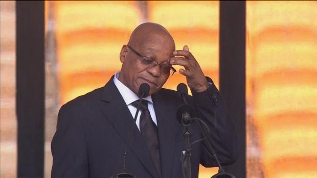Booed: South African President Jacob Zuma at the lectern.