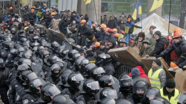 Pro-European Union activists guard the barricades during clashes with riot police in Independence Square on Wednesday.