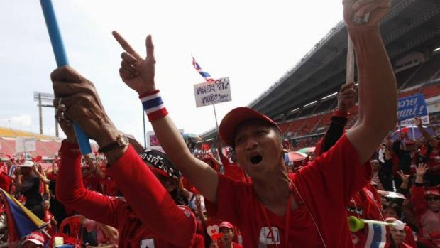 """Preparing to take to the streets again: Pro-government """"red shirt"""" supporters react during a rally in November."""