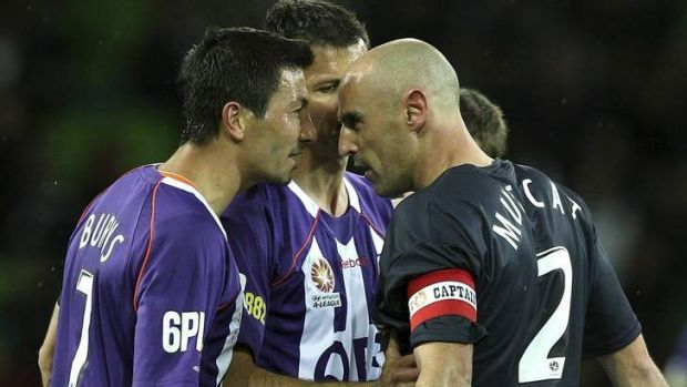 Kevin Muscat (right) argues with Jacob Burns of the Glory argue during a match in 2010.