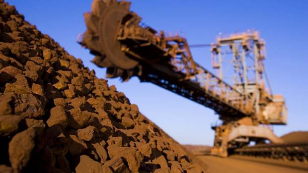 The mining boom peak spells danger for the economy, says a report.