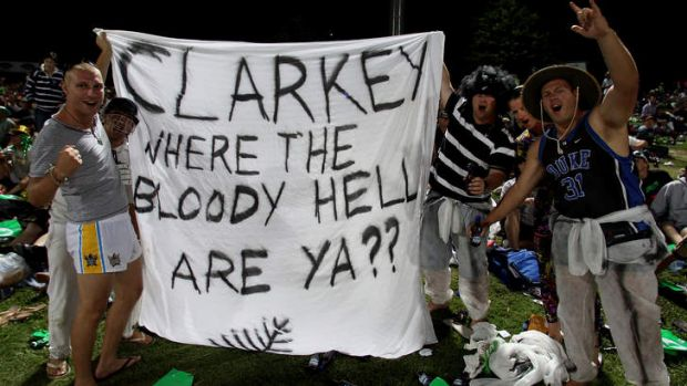 Fans hold up a banner referring to Michael Clarke's decision to quit the tour of New Zealand.