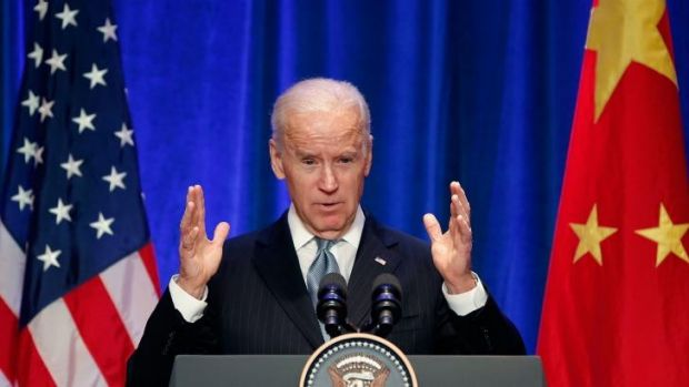 US Vice President Joe Biden raised concerns about US journalists' working visas with Xi Jinping during a visit to Beijing.