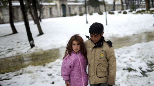 Syrian refugees in the snow in Istanbul. The refugees in Turkey, faced further misery due to increasing shortages of ...