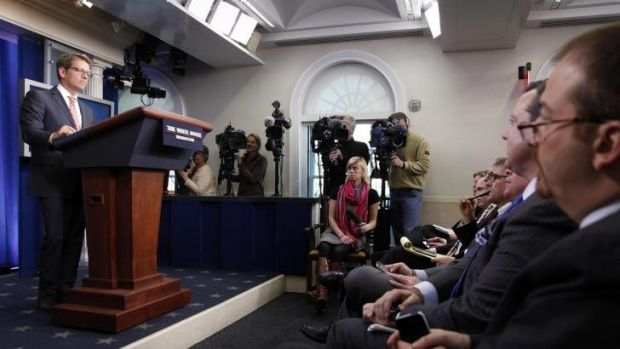 What's wrong with this picture? White House spokesman Jay Carney fronts the media during the daily briefing at the White ...