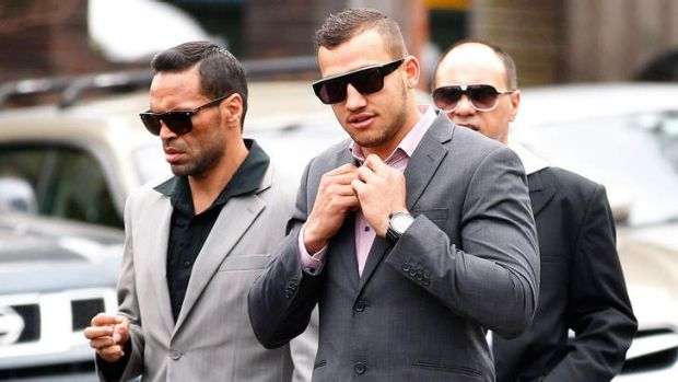 NRL player Blake Ferguson, right, arrives at court with Anthony Mundine in December.