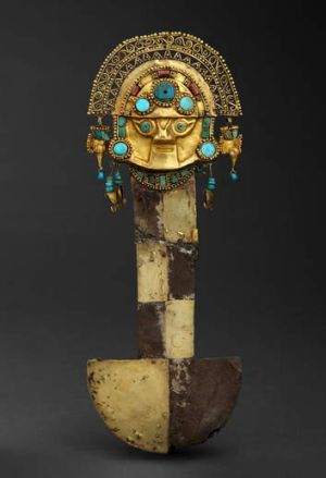 A tumi, or sacrificial knife, made of gold and silver, decorated with chrysocolla turquoise and lapis lazuli.
