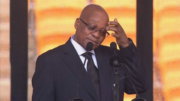 Booed: Zuma's plodding speech was a low point at the Mandela memorial in the FNB Stadium.
