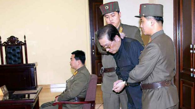 Condemned: Jang Song-thaek, who was later executed, is escorted into court on December 12 after he was branded a traitor.