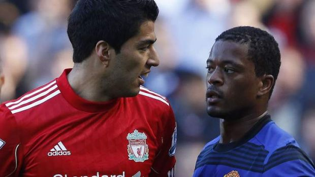 Bitter feud: Liverpool's  Luis Suarez refused to shake Manchester United defender Patrice Evra's hand after a ...