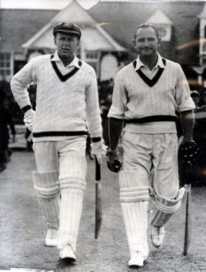 Troubled genius: Sid Barnes (right) heads out to bat with Arthur Morris.