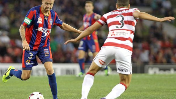 Taylor Regan takes on the Wanderers' defence.
