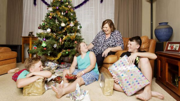 Deck the halls again: Melissa Cooke celebrates Christmas this year with, from left, Hugh, Elisabeth and William.
