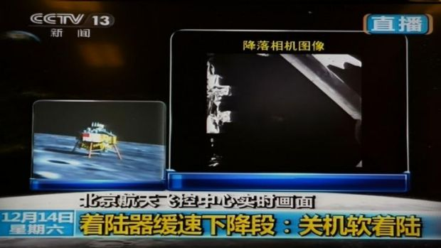 Touchdown: A screen grab from China Central Television's live footage shows China's first lunar rover after it landed on ...