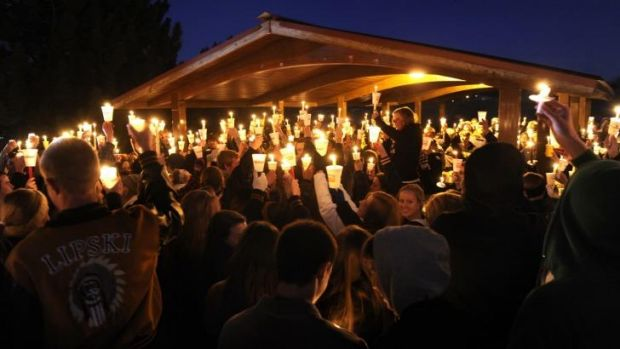 United: Hundreds of Arapahoe High School students gathered for a candlelight vigil Saturday night,  to share their ...