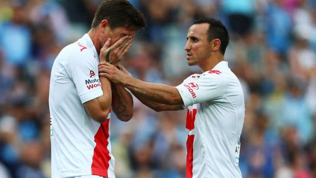 Bad luck continues: Harry Kewell, left, reacts with Michael Mifsud after missing a penalty kick.