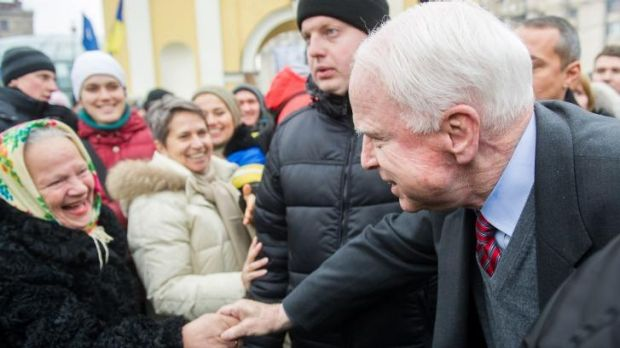 US Senator John McCain in the crowd before addressing the mass rally in Kiev.