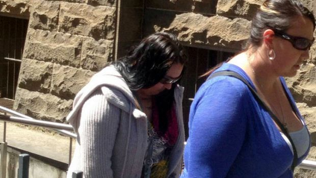 Jayde Poole, left, in grey jumper, leaving court on Monday.