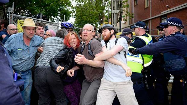 Police and protesters clash at the Westgarth Street drilling site.