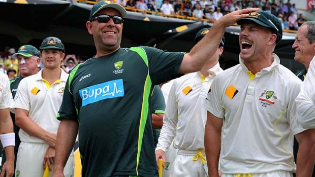 Australian coach Darren Lehmann shares a joke with David Warner after the Ashes were regained.