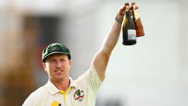 Victory toast: Brad Haddin celebrates with a beer and a bottle of bubbly.