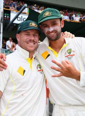I got three: Nathan Lyon indicates how many wickets he took in England's second innings as he poses with David Warner.